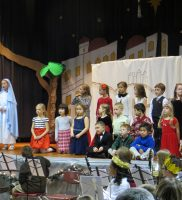 "First grade sings ""O Bethlehem"" with Mary, Caroline M. & Joseph, John C."