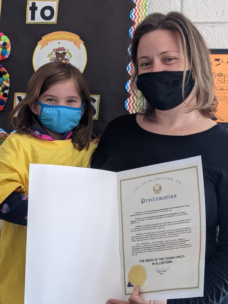 Heather Scherer, Education Director of The Cuddle Zone Learning Center, Allentown, and her daughter Autumn Morris, holding the proclamation from Mayor O'Connell